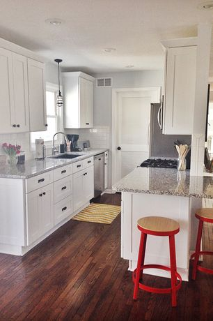 Traditional Kitchen with 2 in. Quartz Countertop in Alpina White, Flat panel cabinets, Flush, Pendant light, Galley