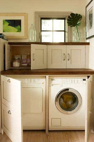 Craftsman Laundry Room with Hardwood floors, Wide plank flooring baked bread, Miele White T8023 C Condenser Dryer