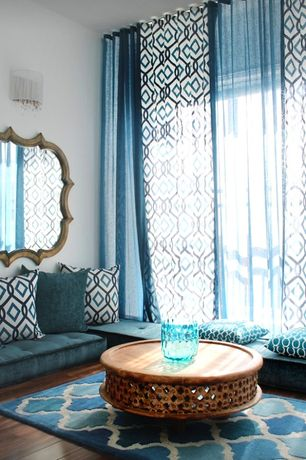 Eclectic Living Room with Wall sconce, Window seat, Diamond Ikat Embroidery Pillow Cover, Hardwood floors