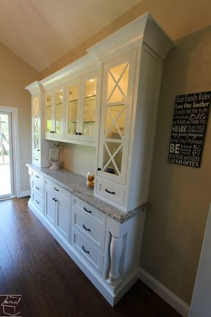 Country Kitchen with French doors, Handscraped wood floors, Glass panel, Complex granite counters, Flat panel cabinets
