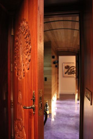 Eclectic Hallway with simple marble floors, Wall sconce, interior wallpaper, specialty door