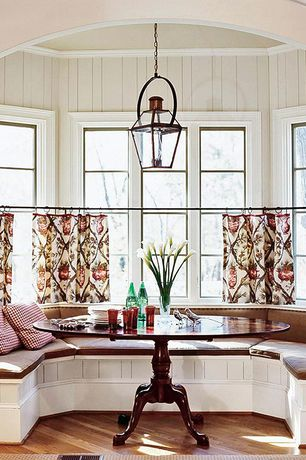 Traditional Dining Room with Hardwood floors, Paint 2, Window seat, Esme Bruno Pedestal Table, Pendant light, High ceiling