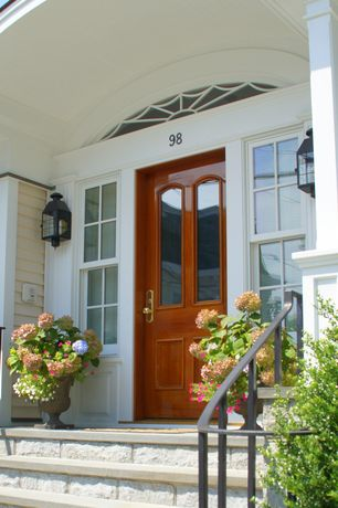 Traditional Front Door with Transom window, exterior stone floors, Glass panel door, double-hung window, Deck Railing