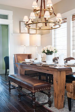 Traditional Dining Room with Wainscotting, Chandelier, Hardwood floors