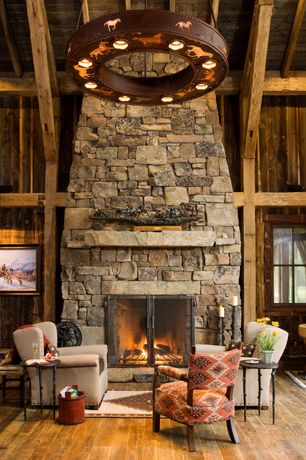 Rustic Living Room with Comfort Pointe Dante Chenille Arm Chair, stone fireplace, Exposed beam, Fireplace, High ceiling
