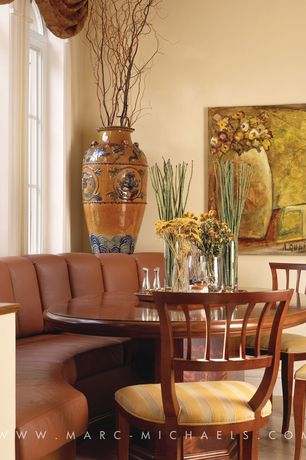 Traditional Dining Room with Concrete floors