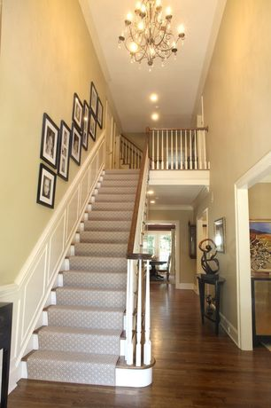 Traditional Staircase with Wainscotting, curved staircase, Columns, Laminate floors, Standard height, Crown molding, Loft