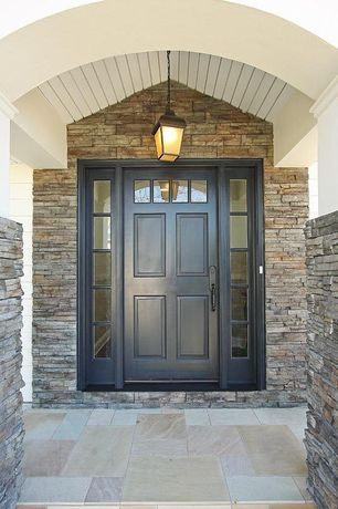 Traditional Front Door with Transom window, exterior stone floors, Stacked stone wall