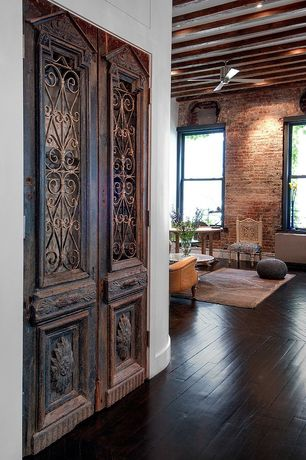 Traditional Living Room with Vintage Carved Wood Door Panels - Pair, High ceiling, Hardwood floors, Exposed beam, Ceiling fan