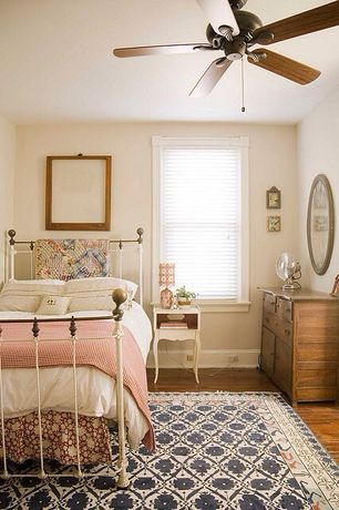 Traditional Guest Bedroom with Tommy Bahama Home Island Estate Barbados 3 Drawer Nightstand, Hardwood floors, Ceiling fan
