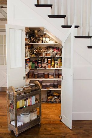 Country Pantry with Custom cabinetry, Standard height, can lights, Hardwood floors, Under stair pantry, Under stair storage