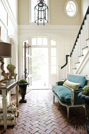 Traditional Entryway with Transom window, Chandelier, High ceiling, herringbone tile floors