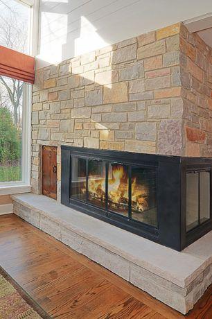 Rustic Living Room with Bruce American Originals Copper Dark Red Oak 3/4 in. Thick x 2-1/4 in. Wide Solid Hardwood Flooring