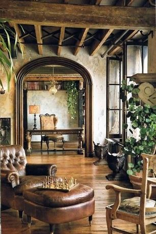 Mediterranean Living Room with Hardwood floors, Built-in bookshelf, interior wallpaper, Exposed beam, Pendant light, Casement