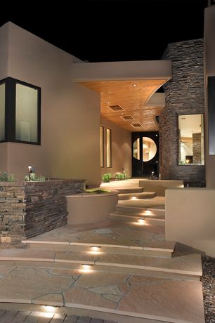 Contemporary Front Door with Aspen / ledge stone, Glass panel door, exterior stone floors, Pathway, Raised beds