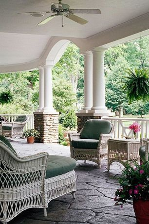 Traditional Porch with exterior stone floors, Wrap around porch