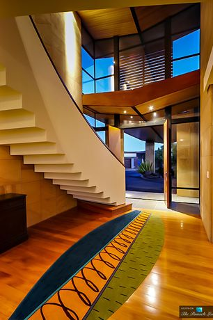 Modern Entryway with Loft, Hardwood floors, Cathedral ceiling, Built-in bookshelf, Transom window
