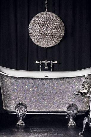 Eclectic Master Bathroom with Metal side table, Chandelier, Curtain wall, Catchpole & rye - swarovski element saracen bathtub