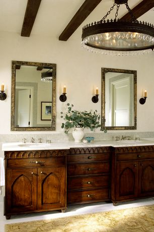 Mediterranean Master Bathroom with Undermount sink, Double sink, Master bathroom, herringbone tile floors, Exposed beam