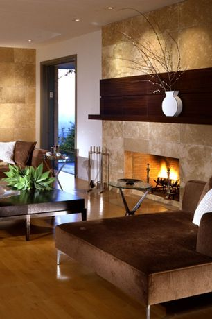 Contemporary Living Room with Hardwood floors, Armstrong maple cinnamon hardwood, Latte Travertine Tile