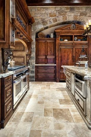 Rustic Kitchen with Custom hood, Sharp Microwave Drawer, slate tile floors, Sub zero panel ready built in refrigerator, Flush