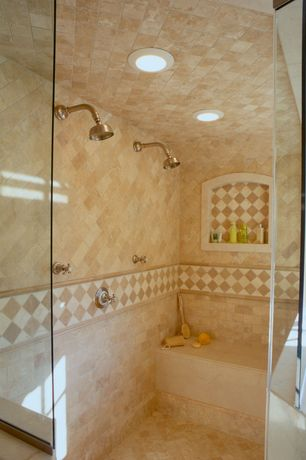 Mediterranean Master Bathroom with Master bathroom, frameless showerdoor, Ms international  ivory travertine