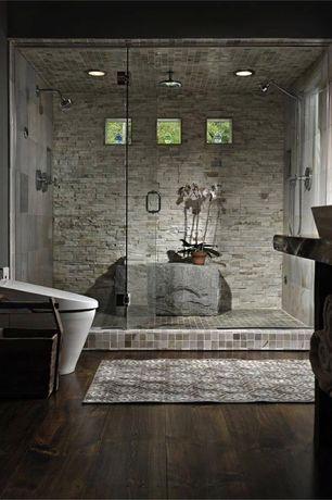 Contemporary Master Bathroom with Arizona Tile Metalwood Bronzo Porcelain Tile, European Cabinets, Handheld showerhead, Flush