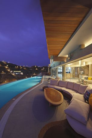 Modern Swimming Pool with Lap pool, exterior concrete tile floors, picture window, exterior tile floors