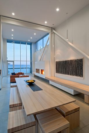 Contemporary Dining Room with Pendant light, Concrete tile