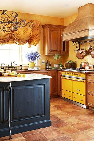 Country Kitchen with Complex marble counters, Kitchen island, Undermount sink, Flat panel cabinets, Custom hood, Raised panel
