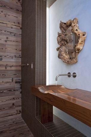 Modern Master Bathroom with Wood counters, Wall sconce, William Garvey Geo Long Wave Basin, Hardwood floors, Undermount sink