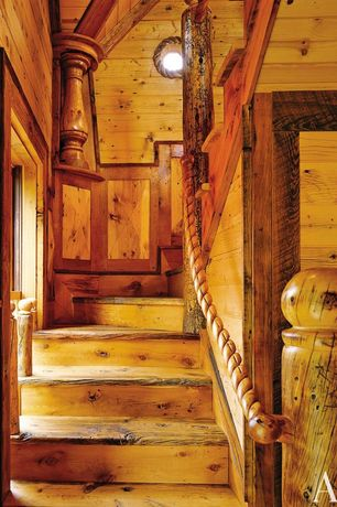 Cottage Staircase with Hardwood floors, Crown molding, Wainscotting
