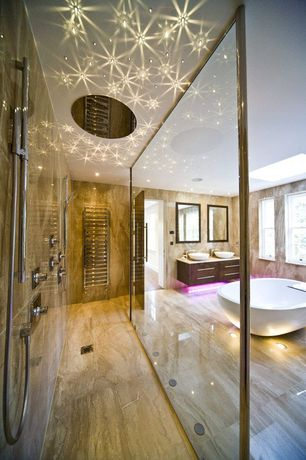 Contemporary Master Bathroom with Steam showerhead, Towel warmer, Vessel sink, Skylight, Double sink, Flush, Freestanding