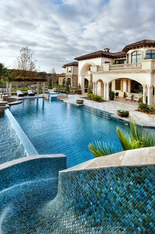 Mediterranean Swimming Pool with Pool with hot tub, Trellis, exterior tile floors, Raised beds, Covered patio, Arched window