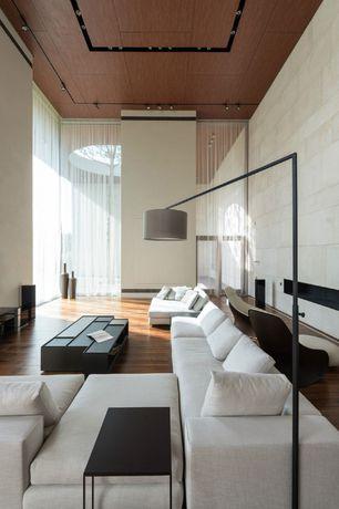 Modern Living Room with Recessed lighting, Hardwood floors, TrueModern Jackson Modular Sectional, Pendant light, French doors