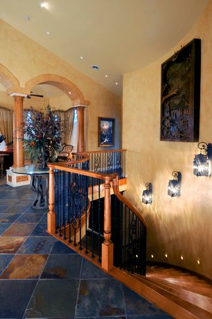 Mediterranean Staircase with onyx tile floors, Hardwood floors, High ceiling, Wall sconce, Columns, Loft