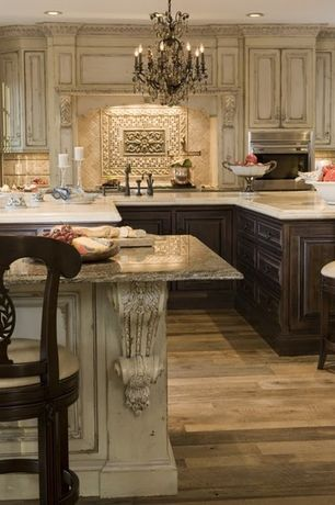 Traditional Kitchen with Complex granite counters, Oregon Tile & Marble Crema Marfil Marble, Kitchen peninsula, Stone Tile