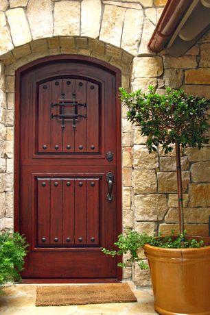 Rustic Front Door with exterior stone floors, Glass panel door