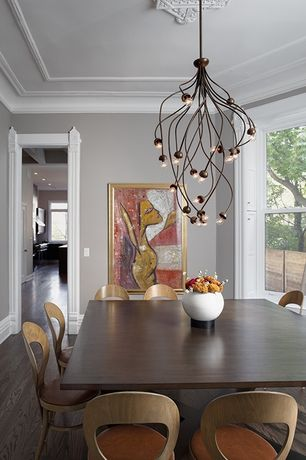 Contemporary Dining Room with Crown molding, Chandelier, Laminate floors