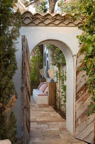 Mediterranean Patio with Pathway, Arbor, Fence, Garden gate, Gate, exterior stone floors