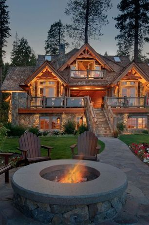 Mediterranean Exterior of Home with Brick and tone paved pathway, Outdoor fire pit, Flagstone pathway, Adirondack chair