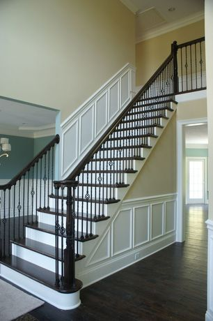 Traditional Staircase with High ceiling, Floating staircase, Loft, Wainscotting, Hardwood floors, Crown molding, French doors