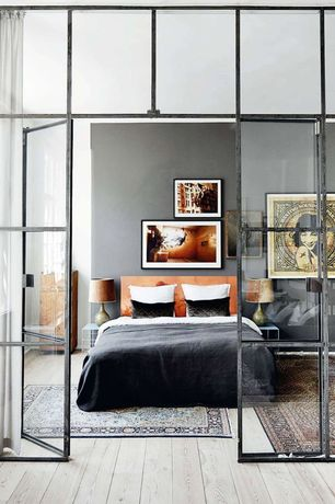 Eclectic Master Bedroom with Art work, Table lamp, Oriental rug, Blackened steel window wall, Interior window, Ash wood floor