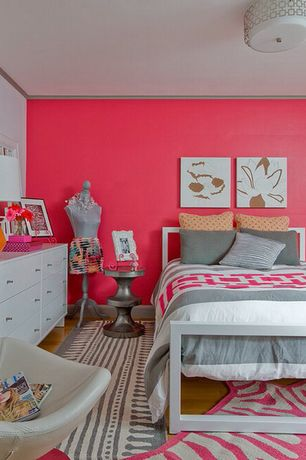 room with Metal bedframe, Crown molding, Carpet runner, Accent pillows, Zebra area rug, Round side table, Chest