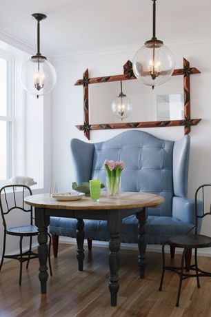 Eclectic Dining Room with Crown molding, Hardwood floors, Pendant light, Globe pendant light, Dining Banquette
