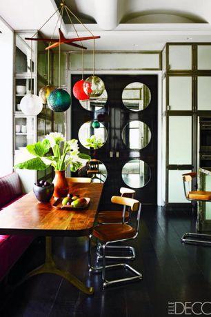 Eclectic Dining Room with Chandelier, Built-in bookshelf, specialty door, Hardwood floors, Transom window