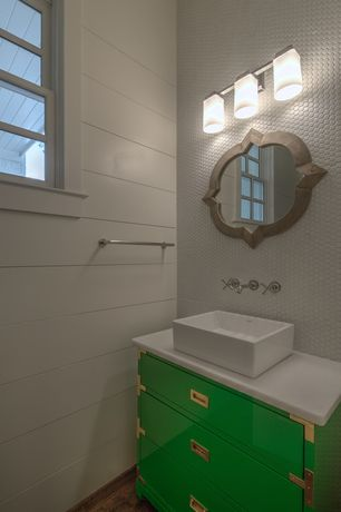 Eclectic Powder Room with Powder room, Penny Tile, European Cabinets, Vessel Sink in White, double-hung window, Vessel sink