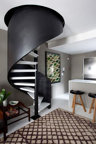 Contemporary Staircase with Built-in bookshelf, Concrete floors, Spiral staircase