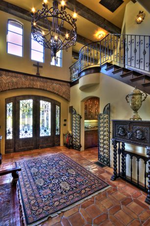 Mediterranean Entryway with Saloon door, Wrought iron railing, French doors, High ceiling, Exposed beam, Chandelier, Paint