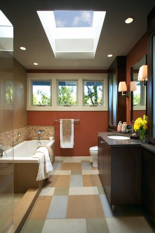 Contemporary Full Bathroom with Casement, Flush, Skylight, ceramic tile floors, Full Bath, Wall sconce, can lights, Bathtub